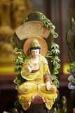 Colorful wooden buddha Stock Photo