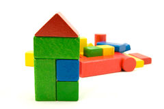Colorful wooden building blocks. On white background stock photos
