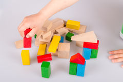 Colorful wooden building blocks. Stack of colorful wooden building blocks on a white background Stock Photo