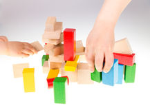 Colorful wooden building blocks. Stack of colorful wooden building blocks on a white background Stock Photography