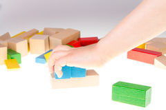 Colorful wooden building blocks. Stack of colorful wooden building blocks on a white background Royalty Free Stock Photo