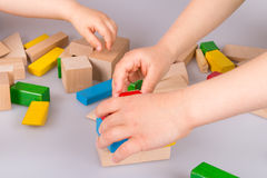 Colorful wooden building blocks. Stack of colorful wooden building blocks on a white background Stock Image