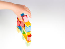 Colorful wooden building blocks. Stack of colorful wooden building blocks on a white background Stock Photos