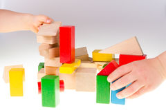 Colorful wooden building blocks. Stack of colorful wooden building blocks on a white background Royalty Free Stock Photos