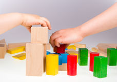 Colorful wooden building blocks. Stack of colorful wooden building blocks on a white background Royalty Free Stock Photography