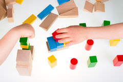 Colorful wooden building blocks. Stack of colorful wooden building blocks on a white background Royalty Free Stock Image