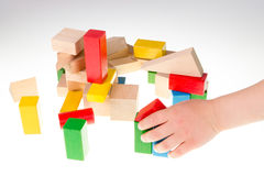 Colorful wooden building blocks. Stack of colorful wooden building blocks on a white background Stock Images