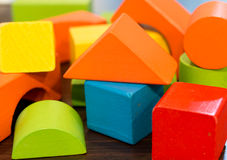 Colorful wooden building blocks. Colorful wooden toy building blocks stock images