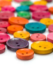 Colorful wooden buttons of various size Stock Photos