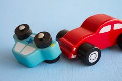 Colorful wooden car crash - Traffic accident auto insurance conc. Ept Stock Photo