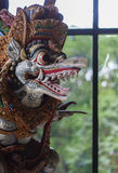 Colorful wooden carved statue of a deity in Indonesia. It is a close up shot of a colorful wooden carved statue of a deity in Indonesia Royalty Free Stock Image