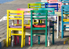 Colorful wooden chairs. Characteristic restaurant with table and colorful chairs on the beach. Royalty Free Stock Photo