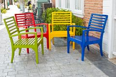 Colorful wooden chairs on various background Stock Photos