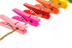 Colorful wooden clothespin isolated. On white background Royalty Free Stock Images