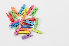 Colorful wooden clothespins on white background royalty free stock photography
