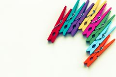 Colorful wooden clothespins on white background with copy space/diversity concept royalty free stock photos