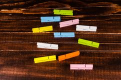 Colorful wooden clothespins on wooden Royalty Free Stock Images