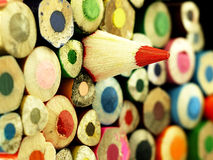 Colorful wooden crayons closely. Royalty Free Stock Images