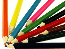 Colorful wooden crayons closely. Royalty Free Stock Photos