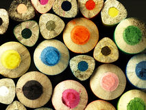 Colorful wooden crayons closely. Stock Photography