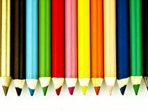 Colorful wooden crayons closely. Royalty Free Stock Photography