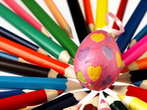 Colorful wooden crayons and Easter egg. Royalty Free Stock Photos