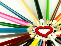 Colorful wooden crayons and red Heart. Royalty Free Stock Images