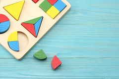 Colorful wooden cubes on blue wooden background. Top view. Toys in the table royalty free stock photography