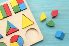 Colorful wooden cubes on blue wooden background. Top view. Toys in the table royalty free stock photo