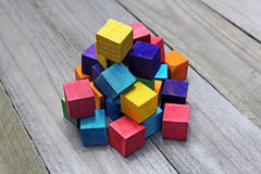 Colorful wooden cubes on wood background Stock Image