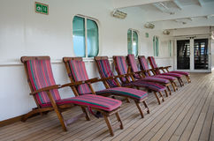Colorful wooden deck chairs Stock Image