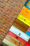 Colorful Wooden Drawer and Brick Wall Stock Photo