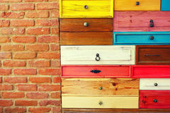 Colorful Wooden Drawer and Brick Wall Royalty Free Stock Photo