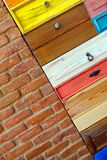 Colorful Wooden Drawer and Brick Wall Royalty Free Stock Photography