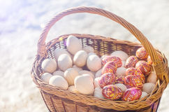 Colorful wooden Easter eggs in basket.  Stock Photo