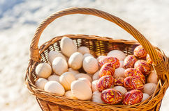Colorful wooden Easter eggs hand-painted in a basket.  Stock Photos