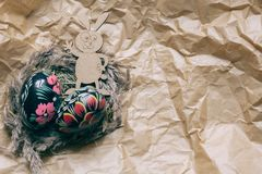 Colorful wooden easter eggs and wooden fanny rabbit on a craft paper background. Toned stock image