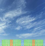 Colorful wooden fence on a blue sky background Stock Photography