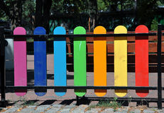 Colorful wooden fence on a playground Stock Photos