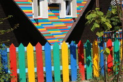 Colorful wooden fence and  roof of the house upside down Royalty Free Stock Photo