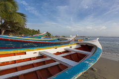 Colorful wooden fisher boats aligned on the beach Royalty Free Stock Images