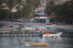 Colorful wooden fisher boats anchored in the bay of Pampatar wit Royalty Free Stock Images