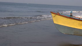 Colorful wooden fishing boat on Arabian sea, India. Colorful wooden fishing boat on Arabian sea beach, India stock video
