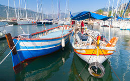 Colorful wooden fishing boats, Corsica island. Colorful wooden fishing boats moored in Propriano town, Corsica, France Stock Images