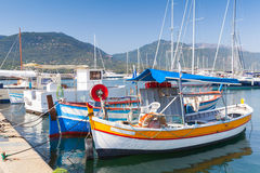 Colorful wooden fishing boats, South Corsica. Small colorful wooden fishing boats moored in Propriano town, Corsica, France Royalty Free Stock Images