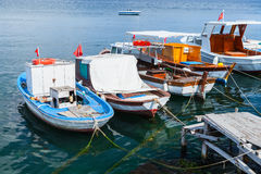 Colorful wooden fishing and pleasure boats. Moored in small port of Avcilar, district of Istanbul, Turkey Stock Photo