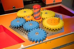 Colorful wooden gears with twisting bar for kid activity and lea. Rning on mechanical engineering basic Royalty Free Stock Photo