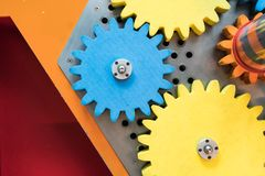 Colorful wooden gears with twisting bar for kid activity and lea. Rning on mechanical engineering basic Stock Photography