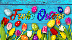 Colorful wooden german happy easter background. Colorful wooden panorama german happy easter background tulips eggs nest basket on rustic old oak light blue wood Royalty Free Stock Images