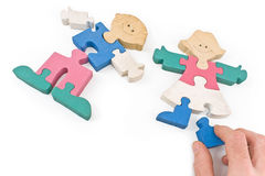 Colorful wooden girl and boy puzzle pieces Stock Photography